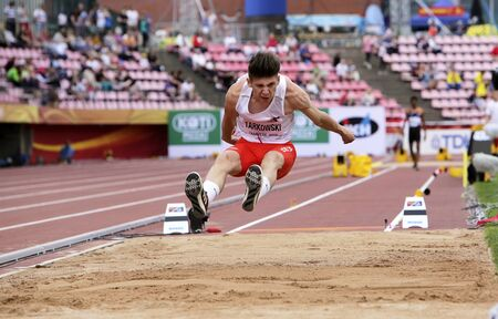 TAMPERE, FINLAND,  July 11: PIOTR TARKOWSKI from POLAND on the long jump event at the IAAF World U20 Championships in Tampere, Finland on July 11, 2018. Foto de archivo - 126230139