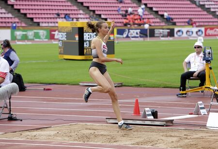 TAMPERE, FINLAND,  July 12: LEA-JASMIN RIECKE from Germany win gold medal in the long jump on the IAAF World U20 Championships on July 13, 2018. Foto de archivo - 126230140