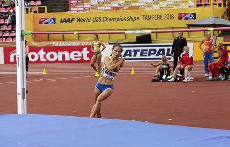 TAMPERE, FINLAND,  July 12: DARIA DIKHANOVA from Ukraine on high jump  in heptathlon in the IAAF World U20 Championship Tampere, Finland 12th July, 2018. Foto de archivo - 126230155
