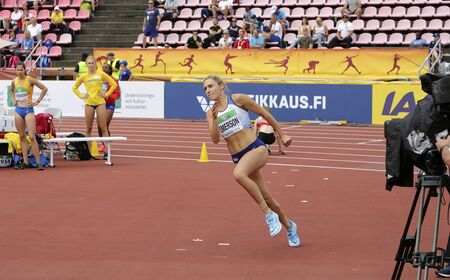 TAMPERE, FINLAND,  July 12: NIAMH EMERSON (GBR), English track and field athlete leeds in heptathlon in the IAAF World U20 Championship Tampere, Finland 12th July, 2018. Foto de archivo - 126230160