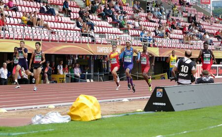 TAMPERE, FINLAND, July 12: Athlets running 200 metrs heats in IAAF World U20 Championship in Tampere, Finland 12 July, 2018. Foto de archivo - 126230162