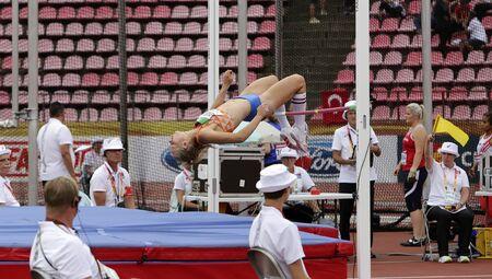 TAMPERE, FINLAND,  July 12: MARIJKE ESSELINK (NETHERLANDS) on high jump heptathlon event in the IAAF World U20 Championship Tampere, Finland 12 July, 2018. Foto de archivo - 126230171