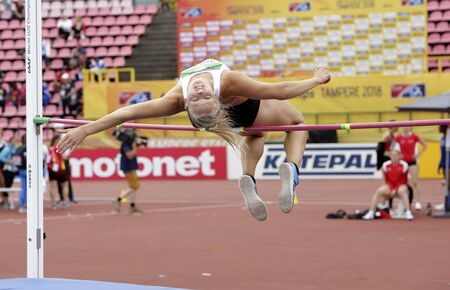 TAMPERE, FINLAND,  July 12: SARAH LAGGER (AUSTRIA), on high jump in heptathlon (win silver summary) in the IAAF World U20 Championship Tampere, Finland 12 July, 2018. Foto de archivo - 126230181