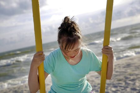 Little girl having fun on the swing