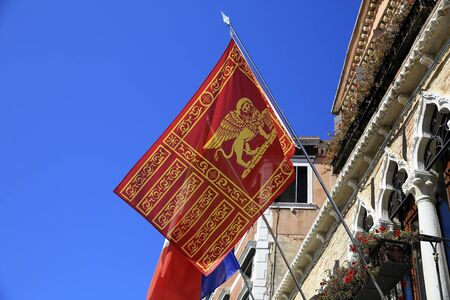 Flag of Venice in venetian building.