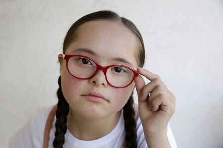 Portrait of little girl with eyeglasses