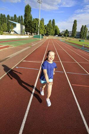 Little girl have fun on the stadium Stock Photo