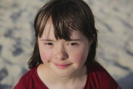 Portrait of down syndrome girl outside
