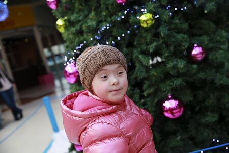 Portrait of young girl on background of the christmas tree