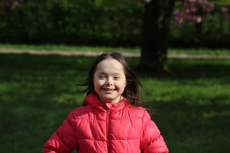 Cute smiling girl in the park