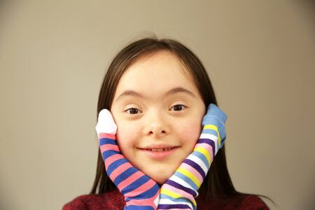 Beautiful girl smiling with different socks