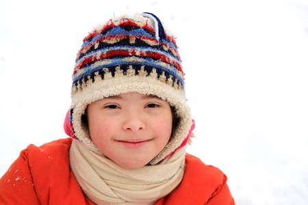 Portrait of little girl smiling on white background Stock Photo