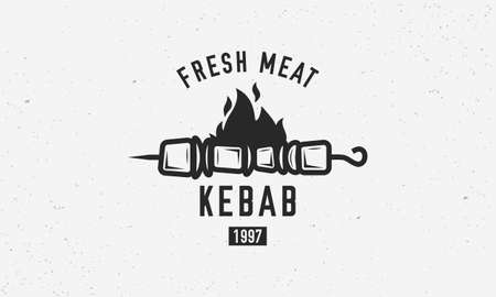 Vintage kebab logo template. Kebab or shashlik on skewer with fire flame isolated on white background. Vector illustration Ilustrace