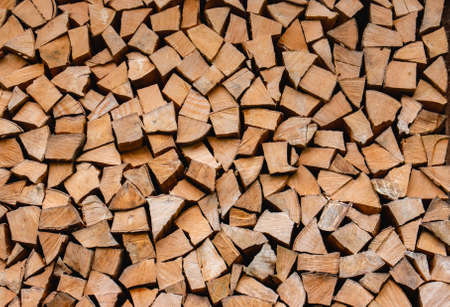 Stacked logs for home heating, background, wallpaper. High quality photo Standard-Bild