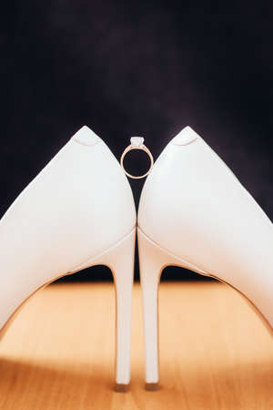 wedding shoes and wedding ring. close up. copyspace 写真素材