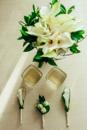 boutonnieres, glasses of whiskey, bridal bouquet. close up 写真素材