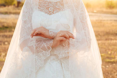 beautiful bride covered herself with veil. Close up. copyspace