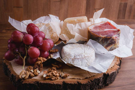 cheese plate on a wooden table. rustic. Close up. 写真素材