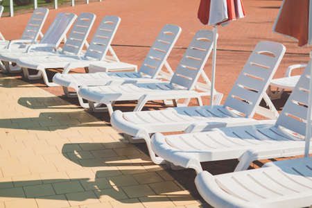 chaise lounges near the pool. Summer. relaxation