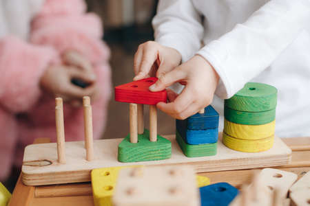 child holds educational toys. Close up.