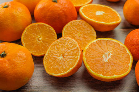 tangerines, peeled tangerine and tangerine slices on a white wooden table. copy space 版權商用圖片