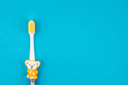 toothpaste and brush on a blue background with place for text. Health, cleanliness and beauty Reklamní fotografie