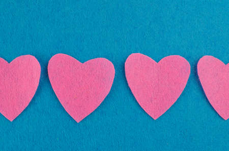 Hand made textile red heart. Isolated on white background. Copy space Фото со стока