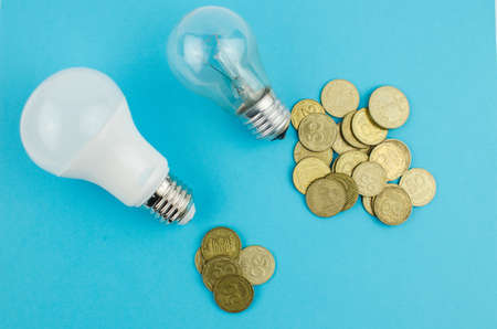 incandescent lamp and energy saving on a blue background. Copy space