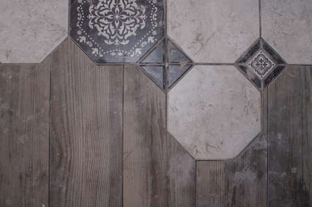 parquet and ceramic tile. background. repair works in cafe