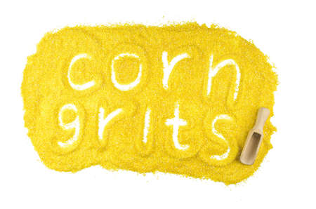 Plate from corn grits with word isolated on white background. Hand Writing. Top view flat lay