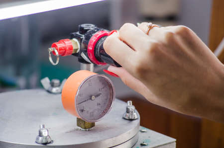 Jeweler working with wax model ring in his workshop.