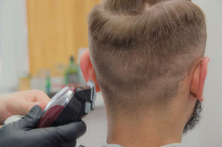 male haircut on a white background. Male hairdresser. Barbershop Stock fotó
