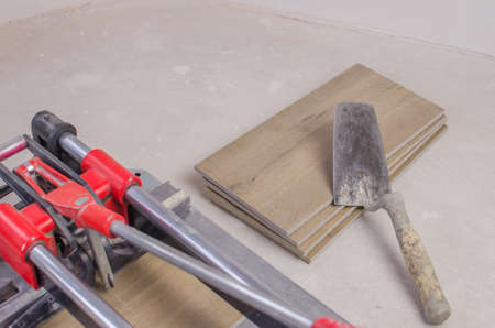 Tile cutter with ceramic tiles and ruler. Close up