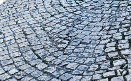 Old cobblestone pavement close-up. Texture for paving stone. Abstract structured background.