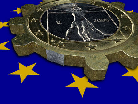 european integration: Economic crisis - broken EURO coin gear Stock Photo