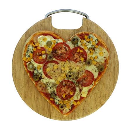 Foto van vegetarische pizza in de vorm van een hart