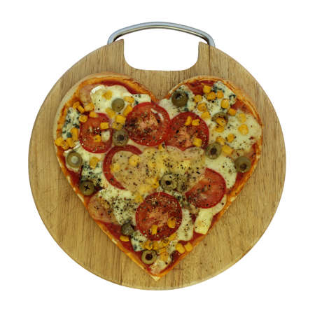 Photo of vegetarian pizza in the shape of heart