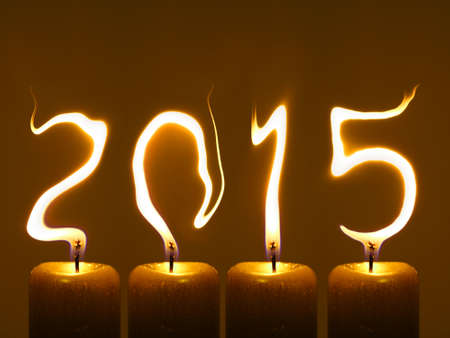 pour feliciter: Happy new year 2015. Flames write numbers 2015.