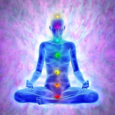 Woman in yoga meditation -  aura and chakras