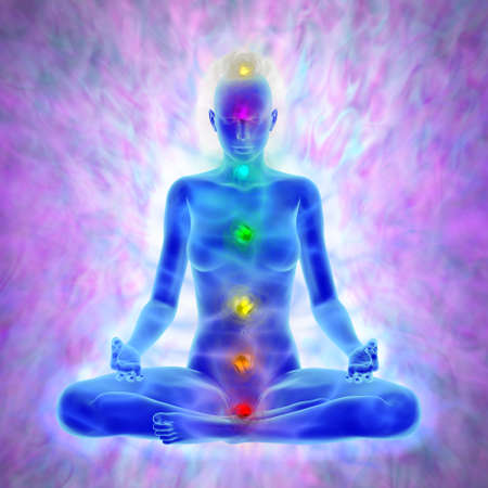 Woman in yoga meditation -  aura and chakras