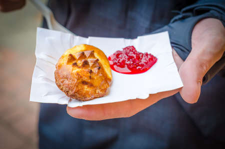 oscypek: Smoked cheese with jam in a hand