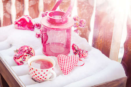 Vintage Candle Lamp with Heart, Hot Cup of Tea on the Snow