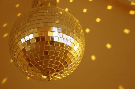 rotated: rotated shiny golden mirror ball in nightclub Stock Photo