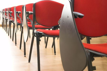 red chair: red chairs rows in conference hall Stock Photo