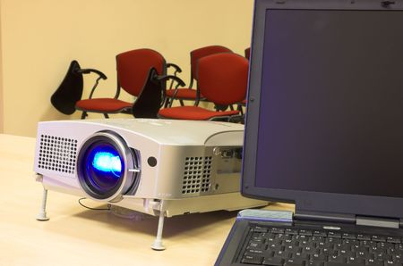 classroom with presentation equipment - notebook and attached projector photo