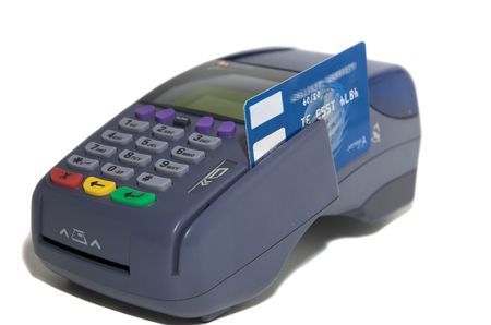 terminal: POS terminal and credit card processing close up and isolated on white Stock Photo