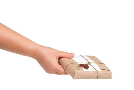 postmaster: delivery hand with parcel isolated on white