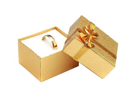 jewelle: golden ring in gift box isolated on white Stock Photo