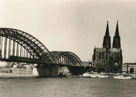 1950s photo of cologne, river rhine, railway bridge and cologne cathedral. photography that I have inherited including the full copyrights. only serious dust and scratches are removed to conserve the original character