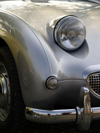 sportscar: detail of classic silver sportscar